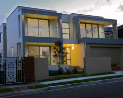 house with large aluminum windows and wooden door
