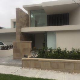 2-storey house with large aluminum sashless window