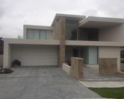 2-storey house with large sashless window