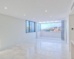 white room with outdoor view