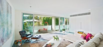 white room with colourful pillows and animal toys