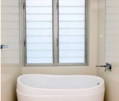 bathroom with louver windows