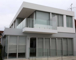side view of a house with multiple aluminum windows