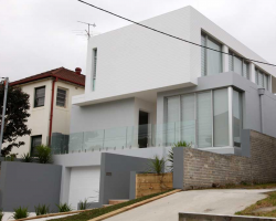 house with wooden door and sashless aluminum windows