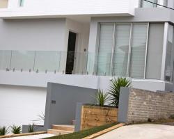 house with wooden door and aluminum windows