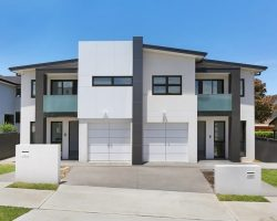 grey and white house with aluminum windows and doors
