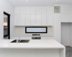 neat kitchen with aluminum windows