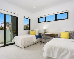 bedroom with sliding doors and awning windows