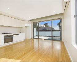 room with wooden floor and sliding aluminum doors