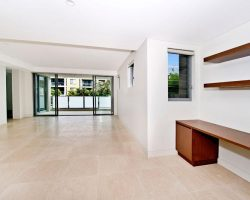 white room with sliding doors